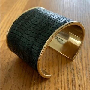 Gold bangle with green alligator detailing